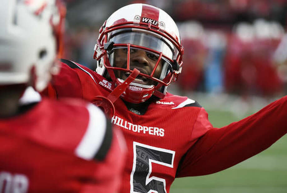 Western Kentucky wide receiver Taywan Taylor (2) , left, celebrates with teammate wide receiver Nicholas Norris (15) after a touch down against Florida International in an NCAA college football game, Saturday, Nov. 5, 2016, in Bowling Green, Ky. (AP Photo/Michael Noble Jr.)