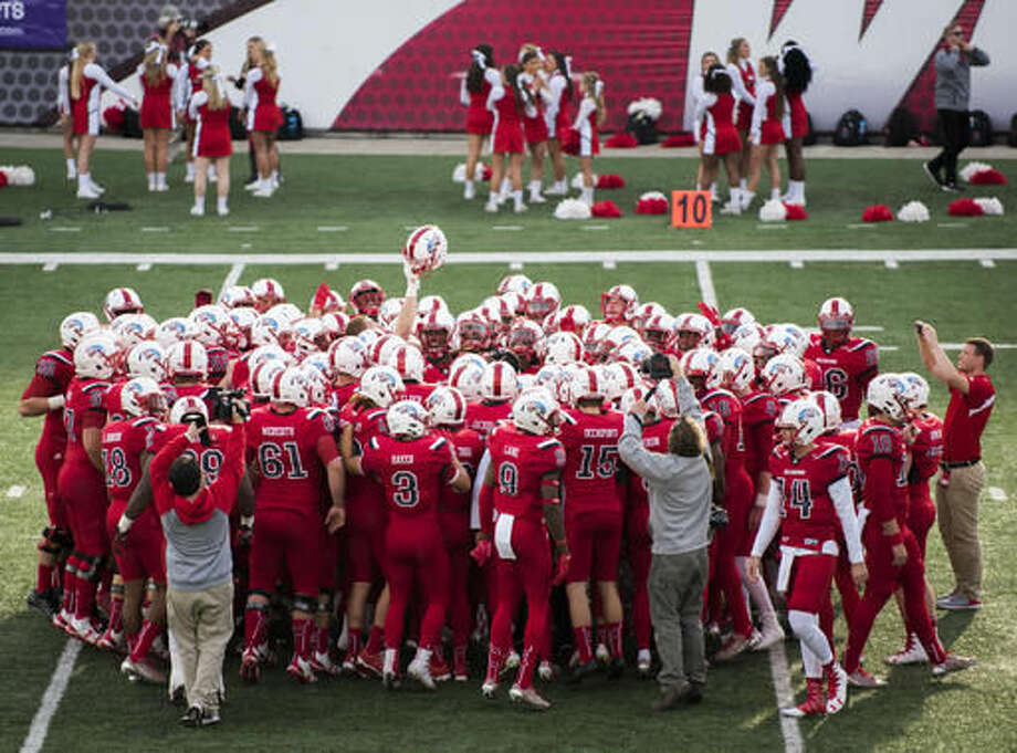 Western Kentucky players gather for a huddle before taking on Florida International in an NCAA college football game, Saturday, Nov. 5, 2016, in Bowling Green, Ky. (AP Photo/Michael Noble Jr.)