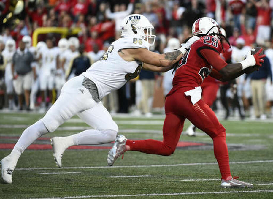 Florida International tight end Jonathan Pavlov (88) attempts to tackle Western Kentucky defensive back Leverick Johnson (29) after a interception in an NCAA college football game, Saturday, Nov. 5, 2016, in Bowling Green, Ky. (AP Photo/Michael Noble Jr.)