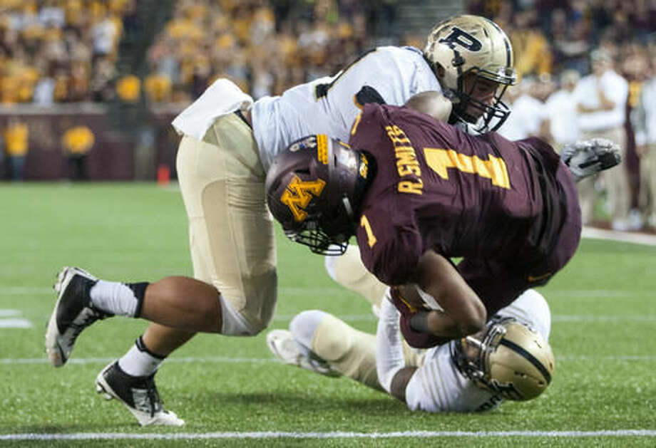 Minnesota running back Rodney Smith (1) tumbles into the end zone after a 14-yard touchdown run against Purdue during the second half of an NCAA college football game, Saturday, Nov. 5, 2016, in Minneapolis. (AP Photo/Paul Battaglia)