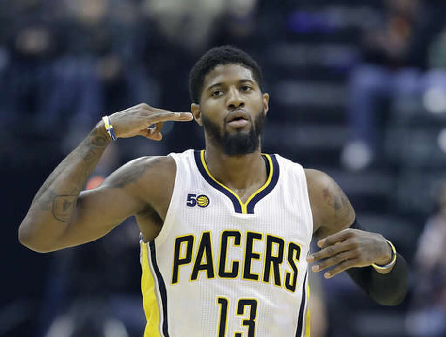 Indiana Pacers' Paul George reacts after hitting a three-point shot during the first half of an NBA basketball game against the Chicago Bulls, Saturday, Nov. 5, 2016, in Indianapolis. (AP Photo/Darron Cummings)