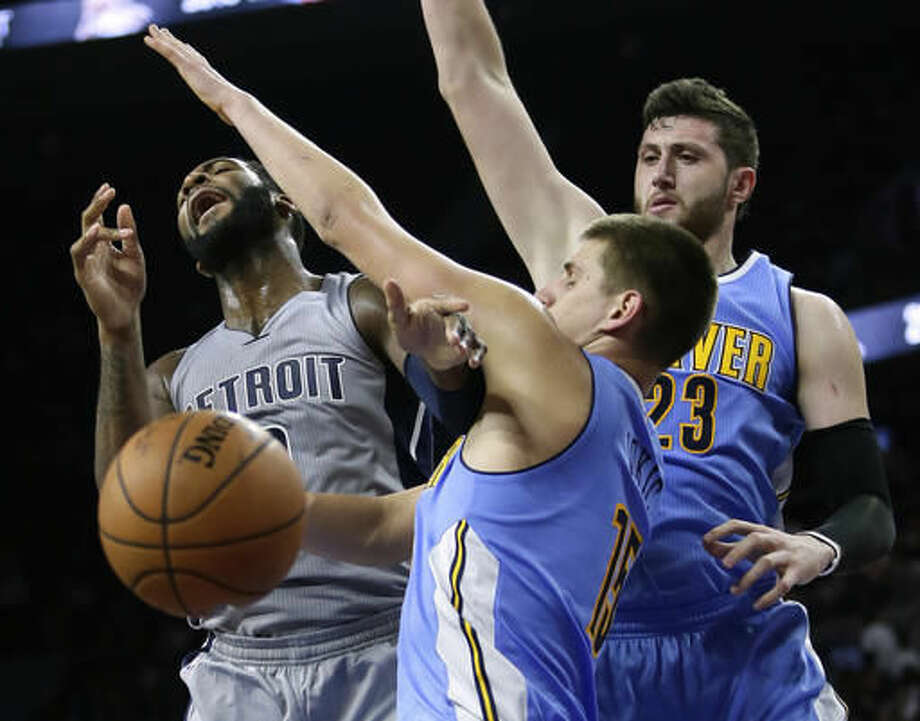 Detroit Pistons' Andre Drummond, left, loses the ball while going to the basket against Denver Nuggets' Nikola Jokic (15) and Jusuf Nurkic (23) during the first half of an NBA basketball game Saturday, Nov. 5, 2016, in Auburn Hills, Mich. (AP Photo/Duane Burleson)