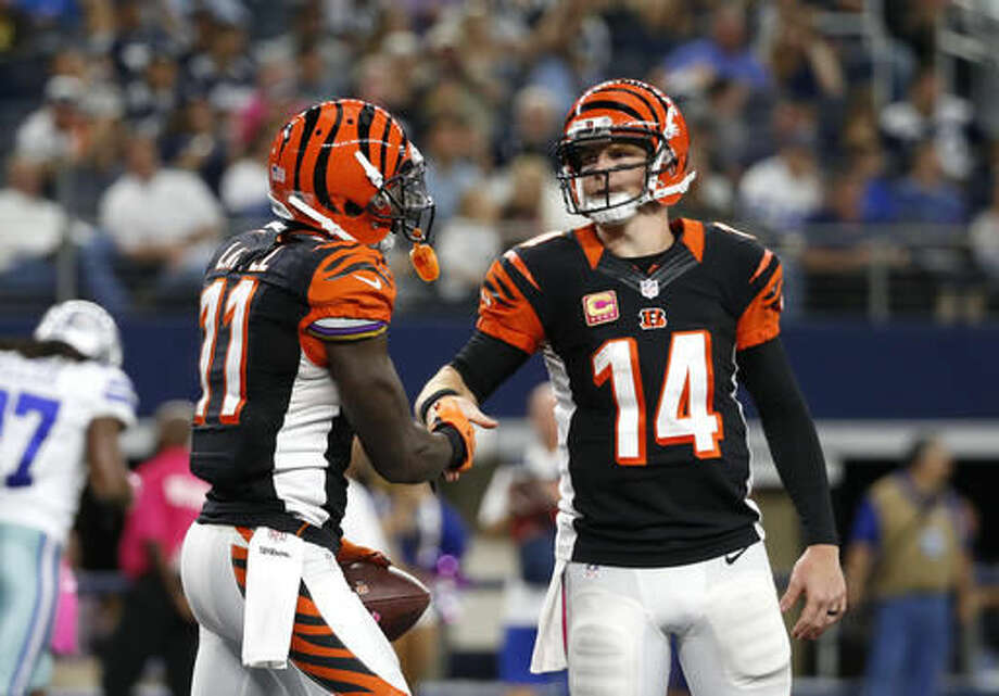 Cincinnati Bengals wide receiver Brandon LaFell (11) and quarterback Andy Dalton (14) celebrate a touchdown catch by LaFell in the second half of an NFL football game against the Dallas Cowboys on Sunday, Oct. 9, 2016, in Arlington, Texas. (AP Photo/Michael Ainsworth)