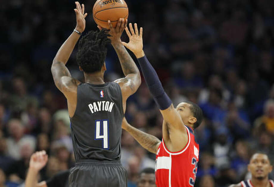 Orlando Magic guard Elfrid Payton (4) shoots over Washington Wizards guard Trey Burke (33) during the first quarter of an NBA basketball game in Orlando, Fla., on Saturday, Nov. 5, 2016. (AP Photo/Reinhold Matay)