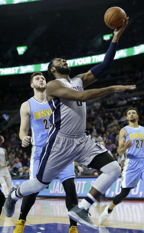 Detroit Pistons' Andre Drummond (0) goes to the basket past Denver Nuggets' Jusuf Nurkic during the first half of an NBA basketball game Saturday, Nov. 5, 2016, in Auburn Hills, Mich. (AP Photo/Duane Burleson)