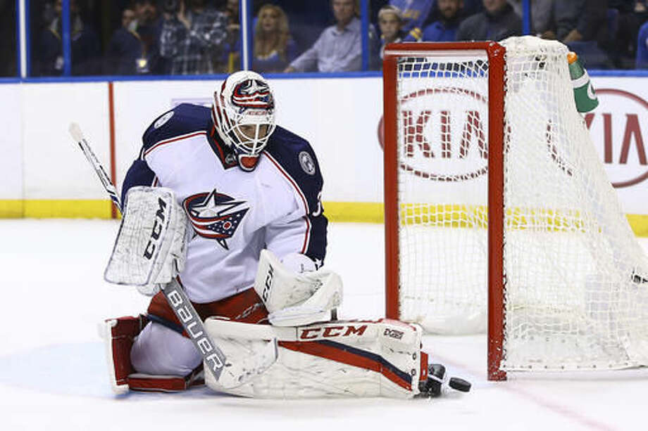 Columbus Blue Jackets goalie Curtis McElhinney block a shot during the second period of an NHL hockey game against the St. Louis Blues, Saturday, Nov. 5, 2016, in St. Louis. (AP Photo/Billy Hurst)