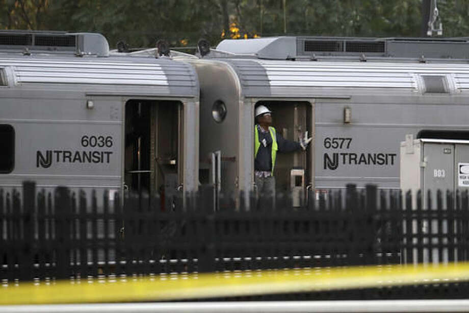 A New Jersey Transit employee rides on a train as it is moved out of the Hoboken Terminal, Thursday, Oct. 6, 2016, in Hoboken, N.J., a week after the train crashed into the station, killing one person and injuring more than 100 people. (AP Photo/Julio Cortez)