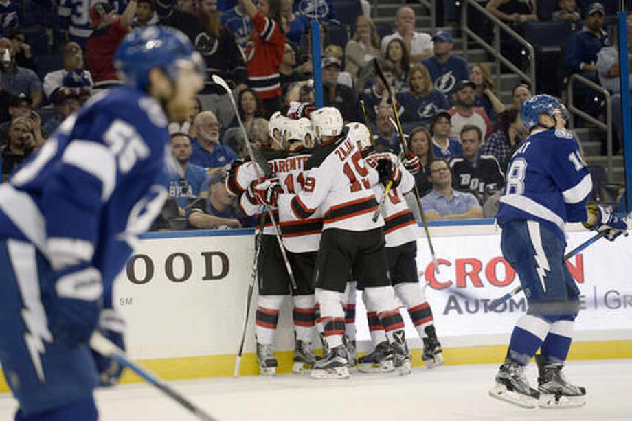 New Jersey Devils celebrate defenseman Damon Severson's (28) goal against the Tampa Bay Lightning during the first period of an NHL hockey game Saturday, Nov. 5, 2016, in Tampa, Fla. (AP Photo/Jason Behnken)
