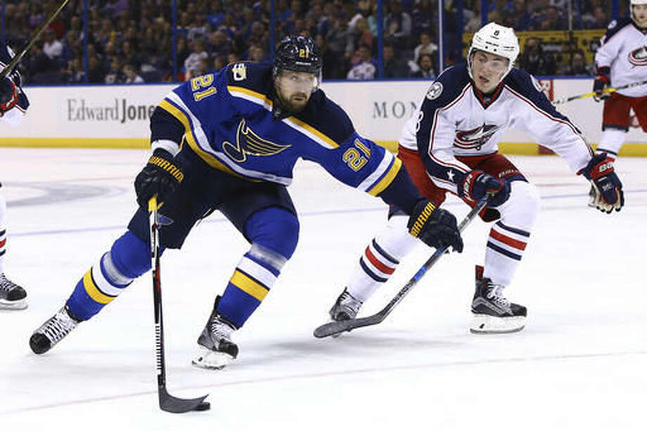 St. Louis Blues' Patrik Berglund, left, of Sweden, brings the puck into the offensive zone as he is pressured by Columbus Blue Jackets' Zach Werenski during the second period of an NHL hockey game Saturday, Nov. 5, 2016, in St. Louis. (AP Photo/Billy Hurst)