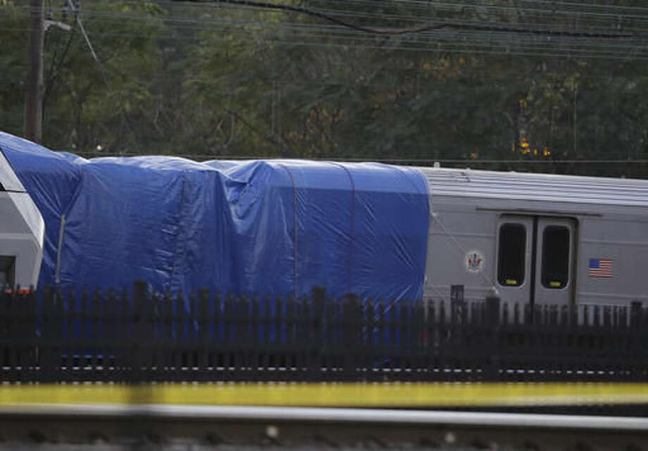 A New Jersey Transit train is moved on the track out of the Hoboken Terminal, Thursday, Oct. 6, 2016, in Hoboken, N.J., a week after the train crashed into the station, killing one person and injuring more than 100 people. (AP Photo/Julio Cortez)