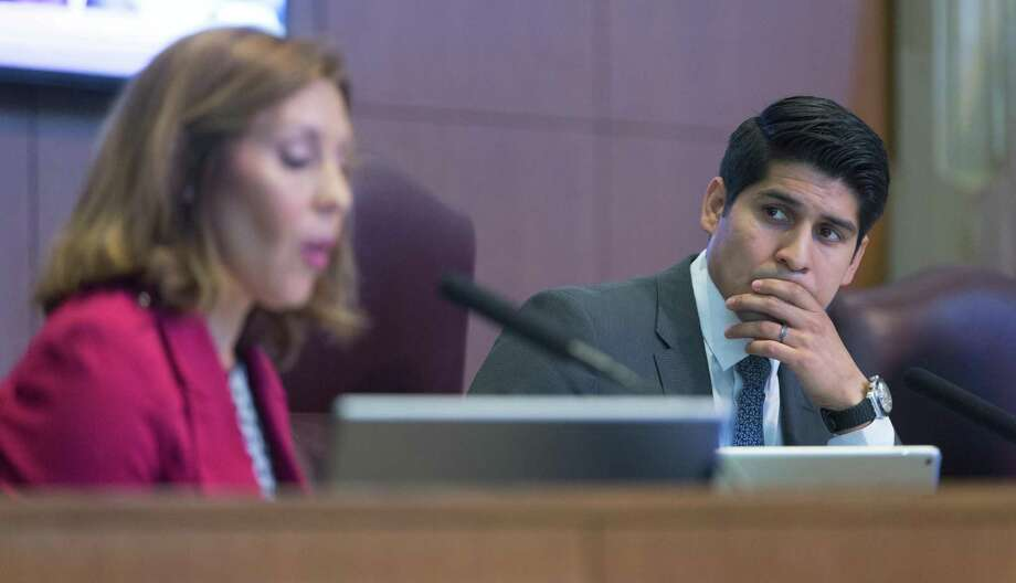 Council member Rey Saldana, right, listens as fellow council member Shirley Gonzales talks Thursday, Dec. 1, 2016 about the slate of planning commissioner candidates up for a council vote. Photo: William Luther, Staff / San Antonio Express-News / © 2016 San Antonio Express-News