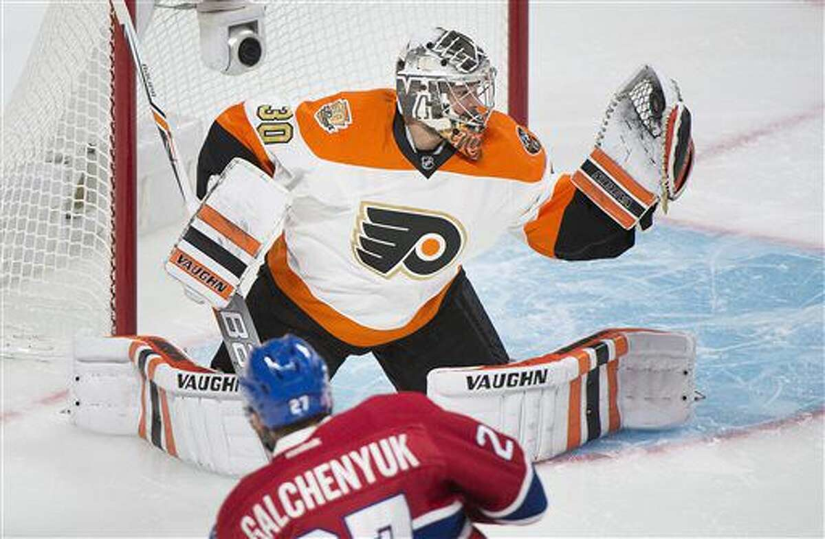 Philadelphia Flyers goaltender Michal Neuvirth makes a save against Montreal Canadiens' Alex Galchenyuk during first period NHL hockey action in Montreal, Saturday, Nov. 5, 2016. (Graham Hughes/The Canadian Press via AP)