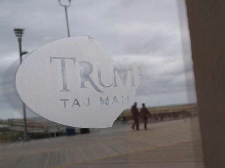 This Wednesday, Oct. 5, 2016 photo, the remnants of a half-gone logo is displayed at the Trump Taj Mahal casino in Atlantic City N.J. The casino is to close at 6 a.m. Monday, Oct. 10, 2016, the fifth Atlantic City casino to go out of business since 2014. (AP Photo/Wayne Parry)