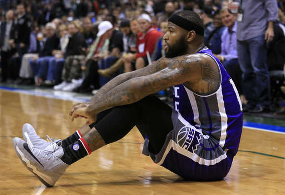 CORRECTS TO DEMARCUS COUSINS NOT TY LAWSON - Sacramento Kings' DeMarcus Cousins takes a moment after being fouled by Milwaukee Bucks forward Giannis Antetokounmpo during the first half of a NBA basketball game Saturday, Nov. 5, 2016, in Milwaukee. (AP Photo/Darren Hauck)