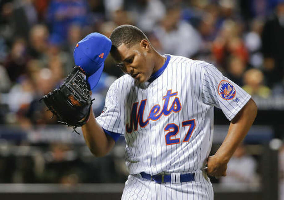 New York Mets relief pitcher Jeurys Familia (27) walks off the field at the end of the top of the ninth inning after giving up a three-run home run to San Francisco Giants' Conor Gillaspie during the National League wild-card baseball game, Wednesday, Oct. 5, 2016, in New York. The Giants won 3-0. (AP Photo/Kathy Willens)