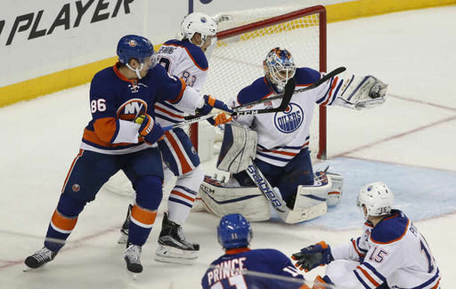 Edmonton Oilers goalie Cam Talbot (33) makes a save on a shot by the New York Islanders during the third period of an NHL hockey game, Saturday, Nov. 5, 2016, in New York. The Oilers won 4-3 in a shootout. (AP Photo/Julie Jacobson)