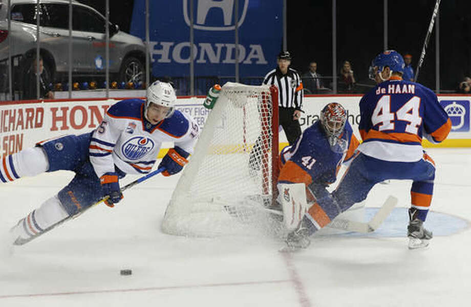 Edmonton Oilers right wing Tyler Pitlick (15) loses his footing as he tries to score on New York Islanders goalie Jaroslav Halak (41) during the first period of an NHL hockey game, Saturday, Nov. 5, 2016, in New York. (AP Photo/Julie Jacobson)