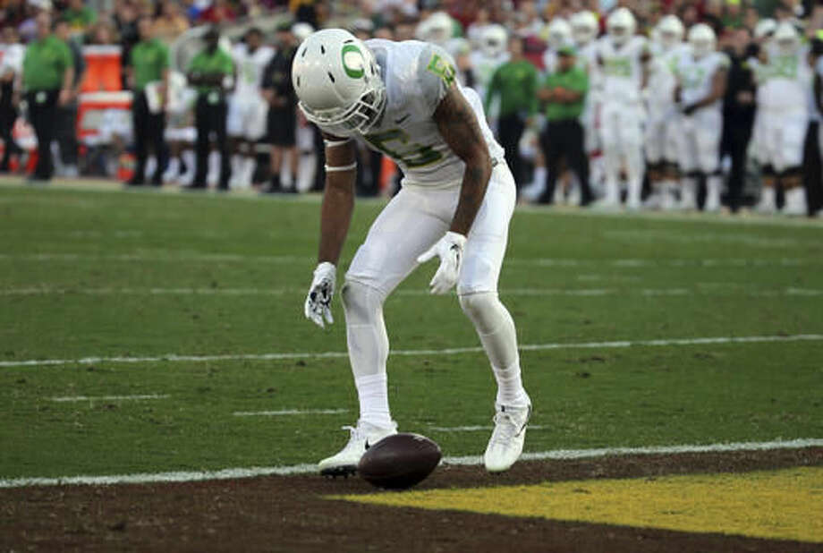 Oregon defensive back Mattrell McGraw (9) stares at the ball after dropping a kickoff from Southern California in the first half of an NCAA college football game in Los Angeles on Saturday, Nov. 5, 2016. (AP Photo/Reed Saxon)