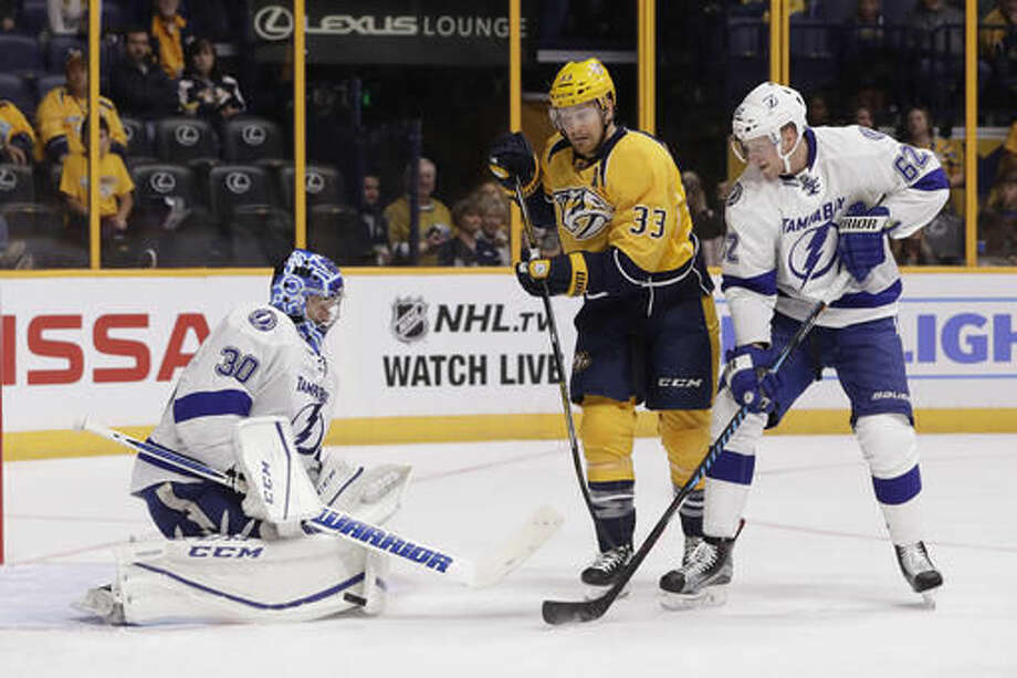 FILE - In this Oct. 1, 2016, file photo, Tampa Bay Lightning goalie Ben Bishop (30) blocks a shot as Nashville Predators left wing Colin Wilson (33) watches for the rebound during the second period of an NHL hockey preseason game in Nashville, Tenn. Bishop is one of the top players to watch in the 2016-17 season. (AP Photo/Mark Humphrey, File)