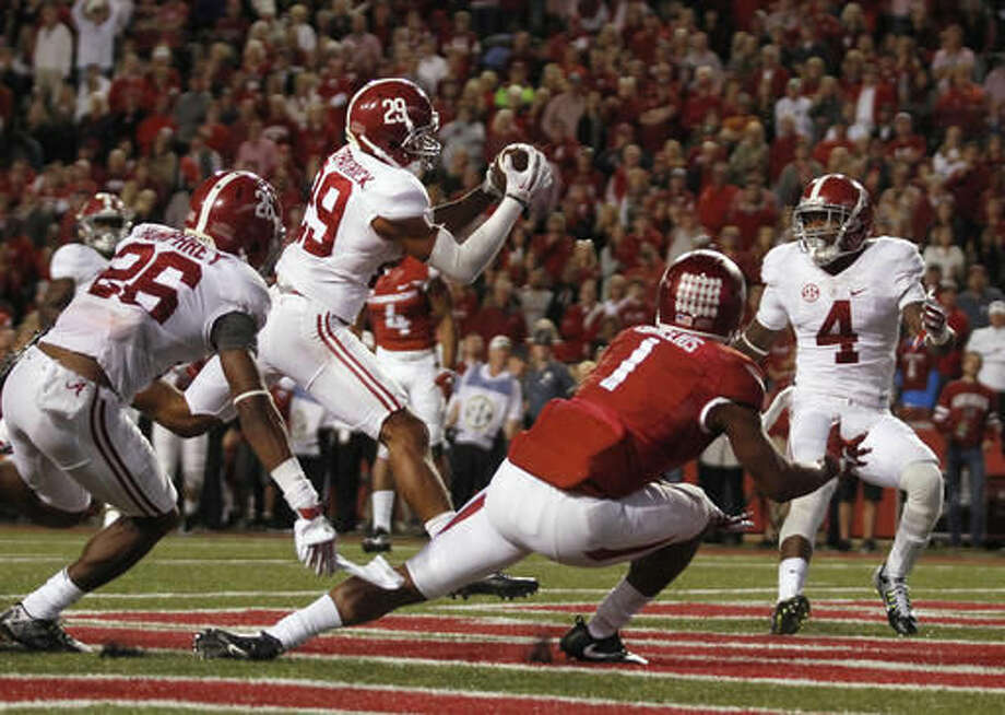 Alabama's Minkah Fitzpatrick (29) intercepts a pass intended for Arkansas' Jared Cornelius (1) in the Arkansas end zone during the fourth quarter of an NCAA college football game Saturday, Oct. 8, 2016, in Fayetteville, Ark. Alabama won 49-30. (AP Photo/Samantha Baker)