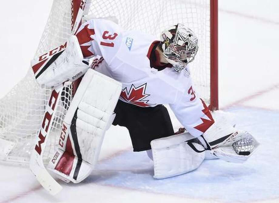 FILE - In this Sept. 29, 2016, file photo, Team Canada goalie Carey Price (31) makes a save against Team Europe during second-period World Cup of Hockey finals action in Toronto. Price is one of the top players to watch in the 2016-17 season. (Nathan Denette/The Canadian Press via AP, File)
