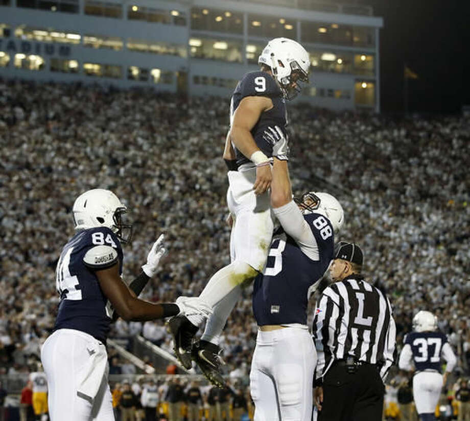 Penn State's Mike Gesicki (88) lifts quarterback Trace McSorley (9) in the air after he scored a touchdown against Iowa during the first half of an NCAA college football game in State College, Pa., Saturday, Nov. 5, 2016. (AP Photo/Chris Knight)