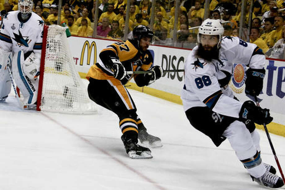 FILE - In this May 30, 2016, file photo, San Jose Sharks' Brent Burns (88) plays against the Pittsburgh Penguins in Game 1 of the Stanley Cup final series in Pittsburgh. Burns is one of the top players to watch in the 2016-17 season. (AP Photo/Keith Srakocic, File)