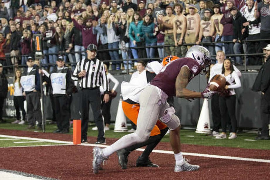 Montana wide receiver Keenan Curran (6) holds on to a pass for a touchdown against Idaho State in the first half of an NCAA college football game Saturday, Nov. 5, 2016, in Missoula, Mont. (AP Photo/Patrick Record)