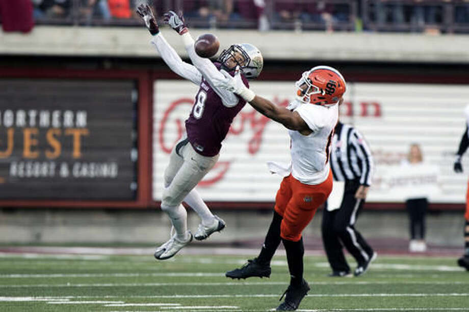 Montana cornerback JR Nelson (18) breaks up a pass intended for Idaho State wide receiver KW Williams (15) in the first half of NCAA college football game Saturday, Nov. 5, 2016, in Missoula, Mont. (AP Photo/Patrick Record)