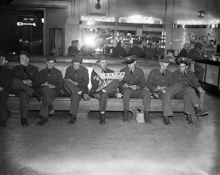 These servicemen waiting at the train station had plenty to say about,  at the Japanese bombing of Pearl Harbor, December 7, 1941 Photo: Photographer Unknown, The Chronicle