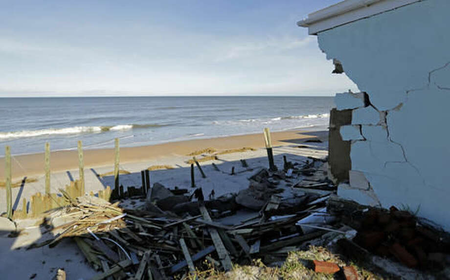 The remains of a seawall stand beyond a destroyed beach home at Ponte Vedra Beach, Fla., Saturday, Oct. 8, 2016, after Hurricane Matthew passed through Friday. (AP Photo/Charlie Riedel)