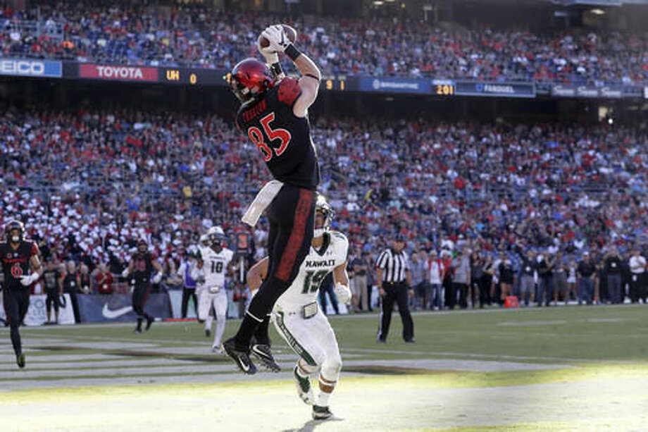 San Diego State wide receiver Quest Truxton makes a touchdown catch in the end zone as Hawaii defensive back Jalen Rogers (19) defends during the first half of an NCAA college football game, Saturday, Nov. 5, 2016, in San Diego. (AP Photo/Gregory Bull)