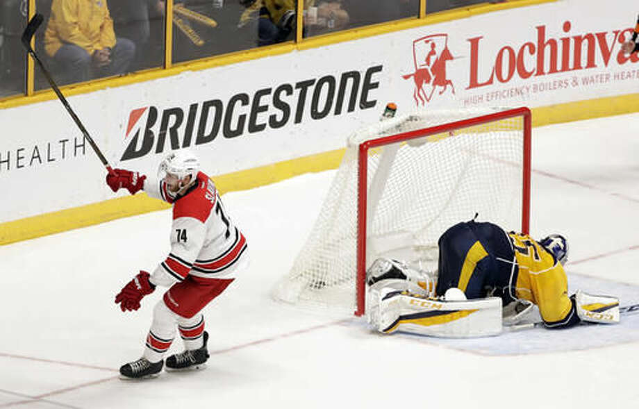 Carolina Hurricanes defenseman Jaccob Slavin (74) celebrates after scoring the winning goal against Nashville Predators goalie Pekka Rinne (35), of Finland, during a shootout at an NHL hockey game Saturday, Nov. 5, 2016, in Nashville, Tenn. (AP Photo/Mark Humphrey)