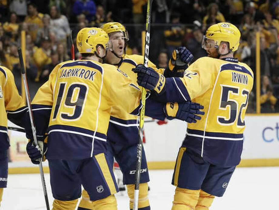 Nashville Predators defenseman Matt Irwin (52) is congratulated by Calle Jarnkrok (19), of Sweden, and Filip Forsberg, center, also of Sweden, after Irwin scored a goal against the Carolina Hurricanes during the second period of an NHL hockey game Saturday, Nov. 5, 2016, in Nashville, Tenn. (AP Photo/Mark Humphrey)