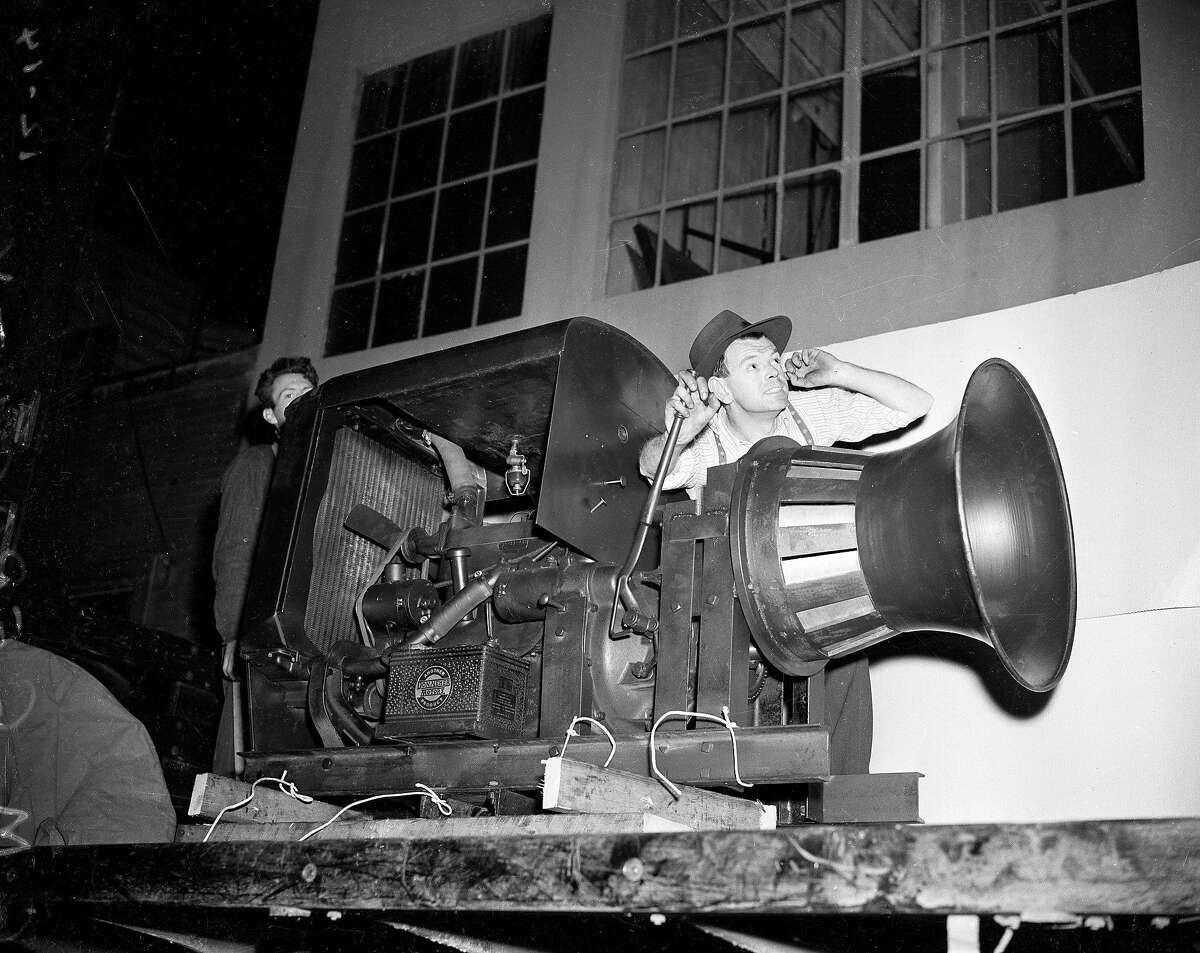 H.M. Geraghty ready to demonstrate an air raid siren manufactured by E.D. Bullard Company in san Francisco Photo ran 12/13/1941