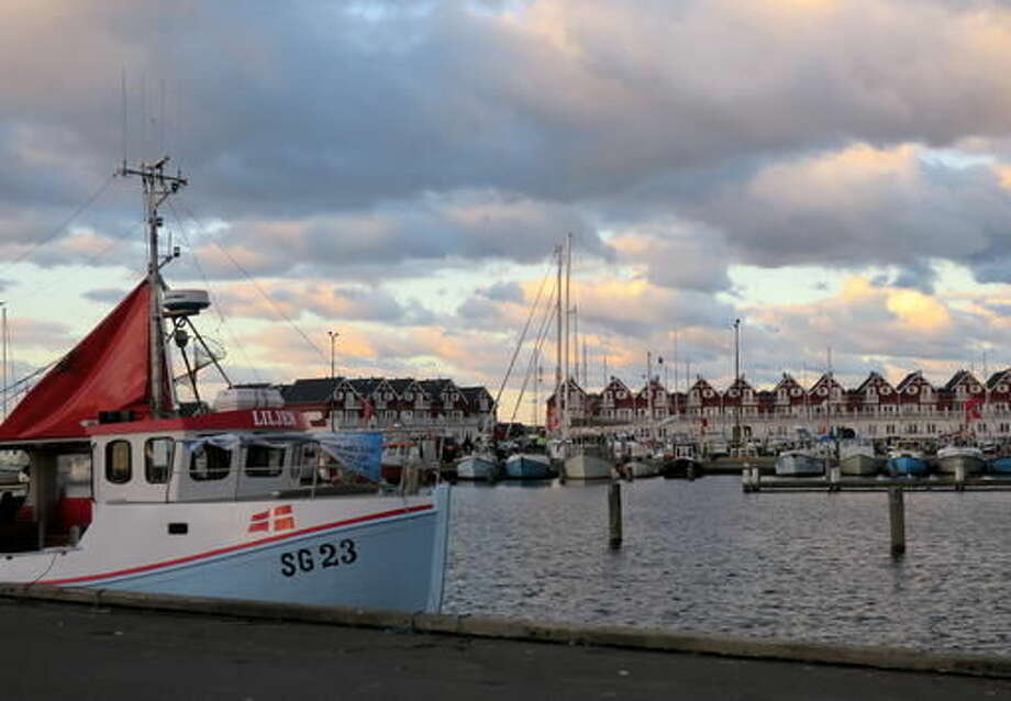 In this Wednesday, Oct. 5, 2016 photo, fishing boats are docked in Bagenkop, Denmark. Ahead of next week's European Union meeting on whether to slash the fishing quota for dwindling cod stock in the western Baltic Sea, coastal fishermen fear they may have to go trawling elsewhere. (AP Photo/ Jan M. Olsen)