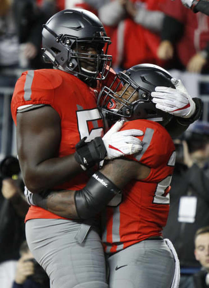 Ohio State running back Mike Weber, right, celebrates his touchdown against Nebraska with teammate Isaiah Prince during the first half of an NCAA college football game Saturday, Nov. 5, 2016, in Columbus, Ohio. (AP Photo/Paul Vernon)