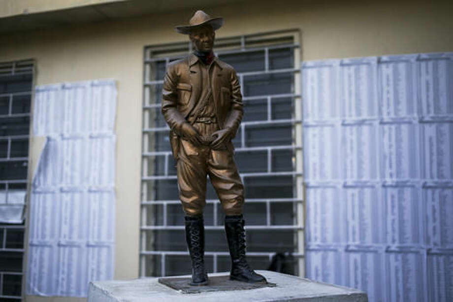 A statue of Nicaraguan hero Augusto Sandino stands between voters lists, inside a polling station, in Managua, Nicaragua, Saturday, Nov. 5, 2016. An estimated 3 million Nicaraguans will go to the polls on Sunday to vote in their country's general election. Ortega and Murillo are considered shoo-ins for the country's top leadership positions. (AP Photo/Esteban Felix)