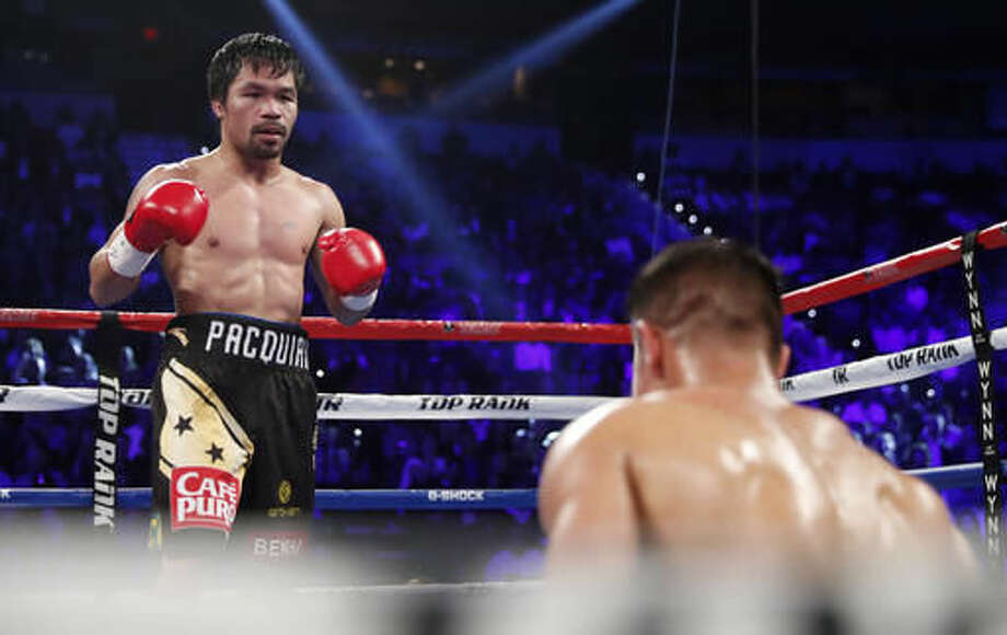 Manny Pacquiao, of the Philippines, knocks down Jessie Vargas during their WBO welterweight title boxing match, Saturday, Nov. 5, 2016, in Las Vegas. (AP Photo/Isaac Brekken)