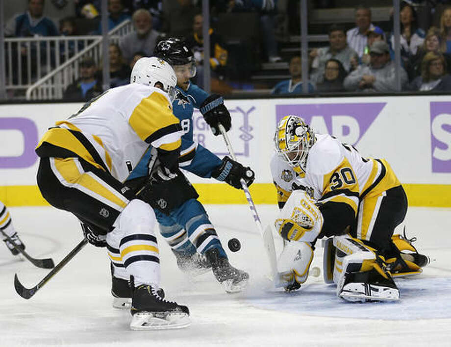 Pittsburgh Penguins goalie Matt Murray (30) blocks a goal attempt by San Jose Sharks center Joe Pavelski (8) as Penguins Olli Maatta, left, defends during the first period of an NHL hockey game Saturday, Nov. 5, 2016, in San Jose, Calif. (AP Photo/Tony Avelar)