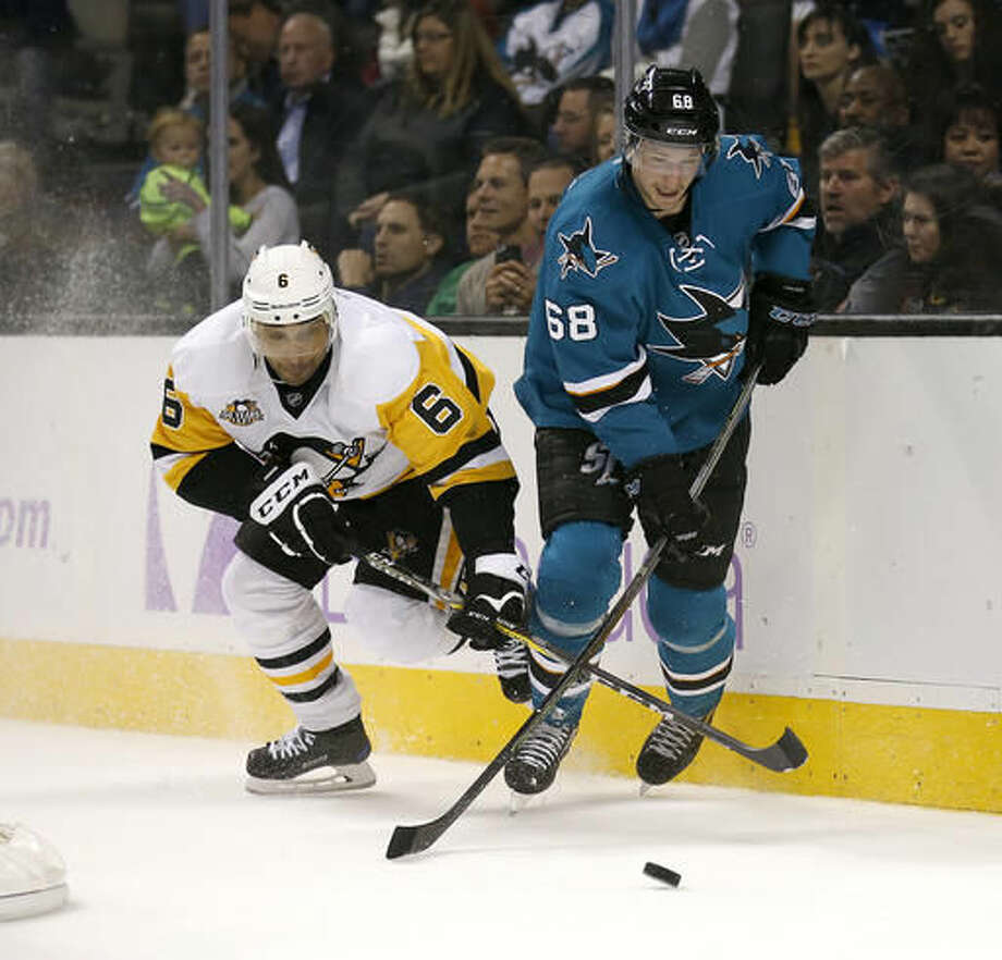 San Jose Sharks center Melker Karlsson (68) battles for the puck against Pittsburgh Penguins defenseman Trevor Daley (6) during the first period of an NHL hockey game Saturday, Nov. 5, 2016, in San Jose, Calif. (AP Photo/Tony Avelar)