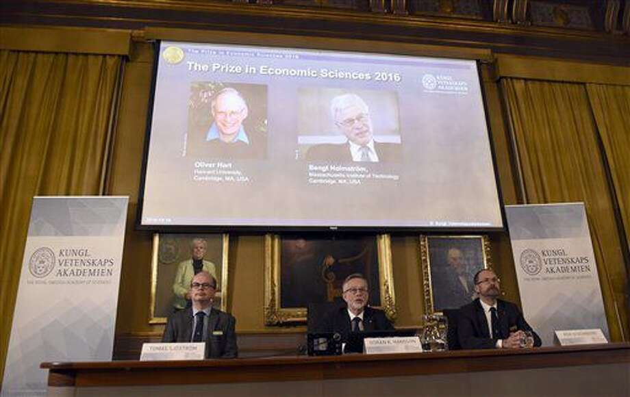 From left, Tomas Sjostrom, member of the Committee for the Prize in Economic Sciences in memory of Alfred Nobel, Goran K. Hansson, Secretary General of the Royal Swedish Academy of Sciences and Per Stromberg, Chairman of the Committee for the Prize in Economic Sciences in memory of Alfred Nobel, attend a press conference to announce Oliver Hart and Bengt Holmstrom as the winners of the Nobel Memorial Prize in economic sciences. (Stina Stjernkvist/TT via AP)