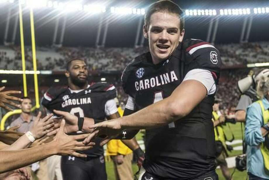 South Carolina quarterback Jake Bentley celebrates with fans after South Carolina's 24-21 win over Tennessee in an NCAA college football game Saturday, Oct. 29, 2016, in Columbia, S.C. (AP Photo/Sean Rayford)