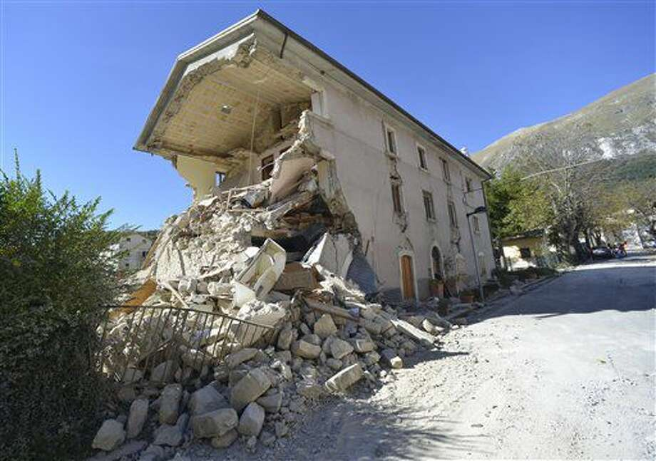 A destroyed house in the village of Pretare, near Arquata del Tronto, Italy, Tuesday, Nov. 1, 2016. Earthquake aftershocks gave central Italy no respite on Tuesday, haunting a region where thousands of people were left homeless and frightened by a massive weekend tremor that razed centuries-old towns. (AP Photo/Sandro Perozzi)