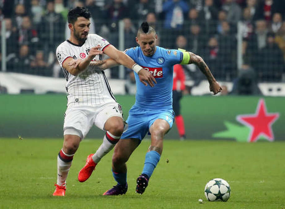 Besiktas' Tolgay Arslan, left, challenges Napoli's captain Marek Hamsik for the ball during the Champions League group B soccer match between Besiktas and Napoli, in Istanbul, Tuesday, Nov. 1, 2016. (AP Photo)
