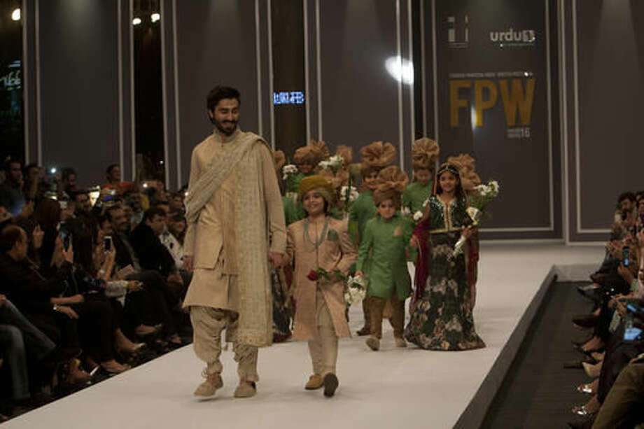 "Pakistani models present creations of a designer Nauman Arfeen during the ""Fashion Pakistan Week Winter Festive 16"", in Karachi, Pakistan, Tuesday, Nov. 1, 2016. More than twenty designers are participating in the three-day event organized by Fashion Pakistan Council to showcase latest collections of luxury and bridal wear. (AP Photo/Shakil Adil)"