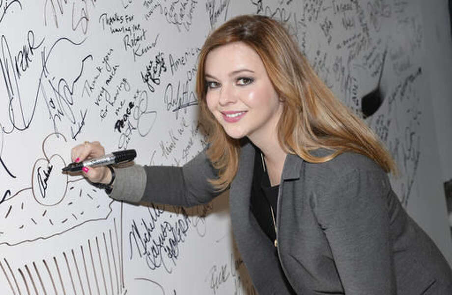"FILE - In this April 14, 2015, file photo, actress Amber Tamblyn participates in AOL's BUILD Speaker Series to discuss herbook of poetry ""Dark Sparkler"" at AOL Studios in New York. Tamblyn said in an Instagram post on Oct. 9, 2016, that the recently discovered crude remarks about women Donald Trump made in 2005 prompted Tamblyn to discuss what she describes an assault by a former boyfriend. (Photo by Evan Agostini/Invision/AP, File)"