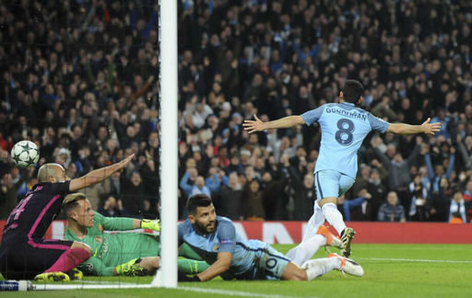 Manchester City's Ilkay Gundogan , right, celebrates after scoring his side's 3rd goal during the Champions League group C soccer match between Manchester City and Barcelona at the Etihad stadium in Manchester, England, Tuesday, Nov. 1, 2016. (AP Photo/Rui Vieira)