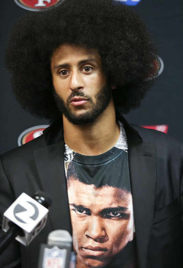 In this Oct. 16, 2016 photo, San Francisco 49ers quarterback Colin Kaepernick talks with the media after an NFL football game against the Buffalo Bills in Orchard Park, N.Y. In recent months, Kaepernick has become comfortable with people knowing him as more than a laser-focused football player as he always previously preferred it. Perhaps, through the anthem protest and his emergence as an outspoken activist for minorities, he has improved his image in the process. (AP Photo/Jeffrey T. Barnes)