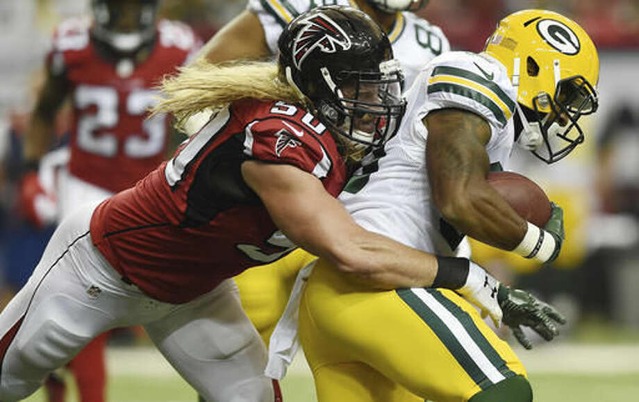 Atlanta Falcons defensive end Brooks Reed (50) tackles Green Bay Packers running back Knile Davis (30) during the first of an NFL football game, Sunday, Oct. 30, 2016, in Atlanta. (AP Photo/Rainier Ehrhardt)